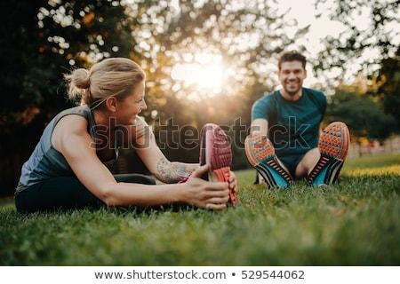 Stretch exercises in park Stock photo © dash