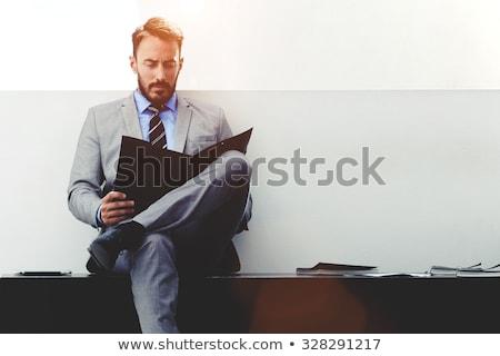 Intelligente Geschäftsmann Lesung Dokument Hintergrund Gläser Stock foto © photography33