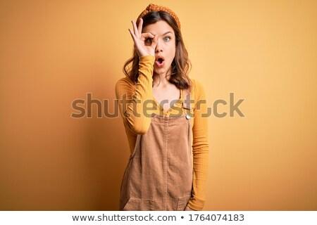 Portrait of the beautiful blonde girl in overalls Stock photo © dashapetrenko
