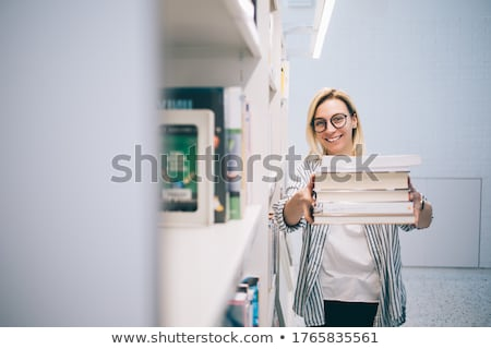 young woman carrying a pile of books stock photo © photography33