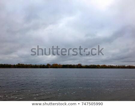 Overcast sky reflecting on water Stock photo © jaymudaliar