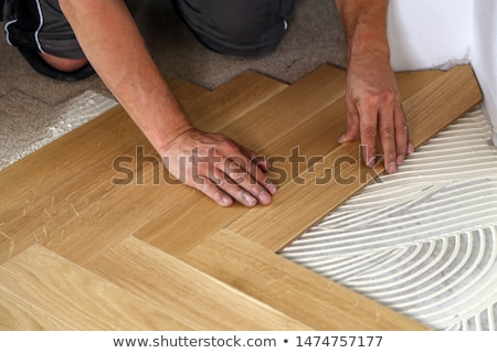 Carpenter installing parquet flooring Stock photo © photography33