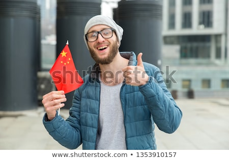 portrait of a happy young business man showing thumbs up sign stock photo © ra2studio