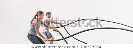 Crossfit battling ropes at gym workout exercise Stock photo © lunamarina