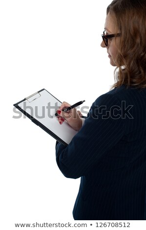 boss filling out the appraisal form of employees stock photo © stockyimages
