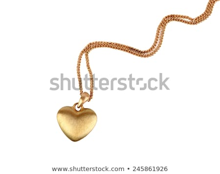 golden heart pendant isolated on white background stock photo © ozaiachin