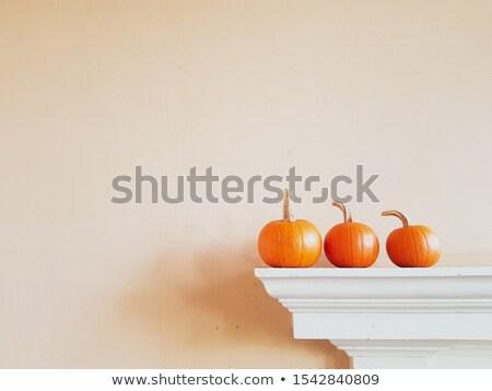 Three pumkins before white background Stock photo © Bertl123