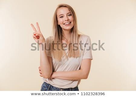 çekici · genç · kadın · zafer · imzalamak · gülen - stok fotoğraf © dolgachov
