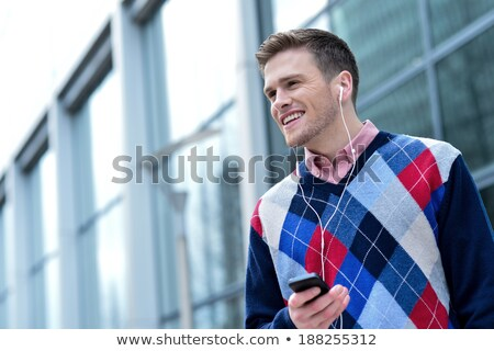 Cool young smiling guy in casual attire Stock photo © stockyimages