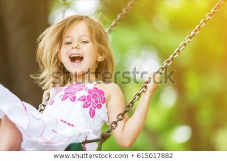 heureux · petite · fille · souriant · Swing · parc · peu - photo stock © aikon