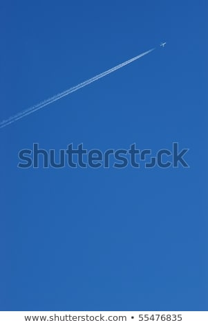 beautiful blue sky with condensation trail of an aircraft  Stock photo © meinzahn