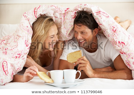 mutlu · çift · içme · çay · yatak · gülen - stok fotoğraf © monkey_business