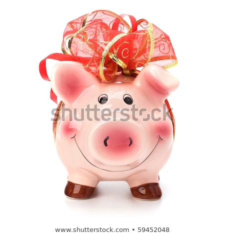 Christmas deposit concept. Piggy bank with festive bow isolated on white. Stock photo © natika