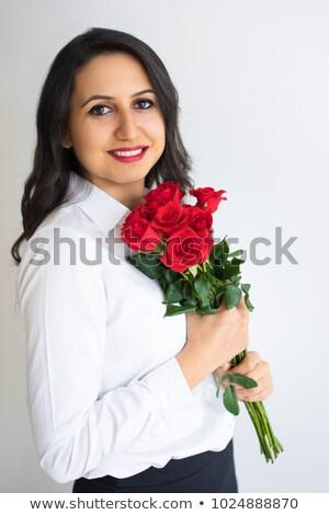 üzletasszony tart piros rózsa virág fiatal felnőtt kaukázusi Stock fotó © bmonteny