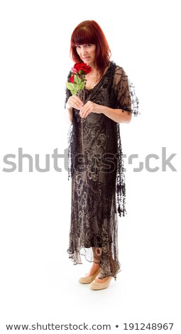 Mature woman bad smelling red rose isolated on a white backgroun Stock photo © bmonteny
