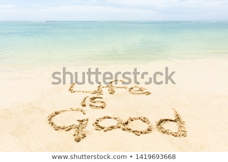 the word holiday written on the sand of a beach stock photo © stryjek