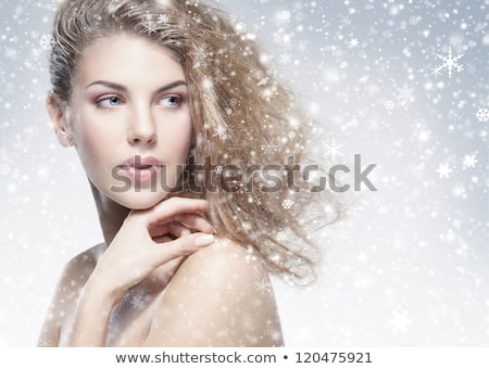 Portrait of a smiling woman with closing eyes over gray background Stock photo © deandrobot