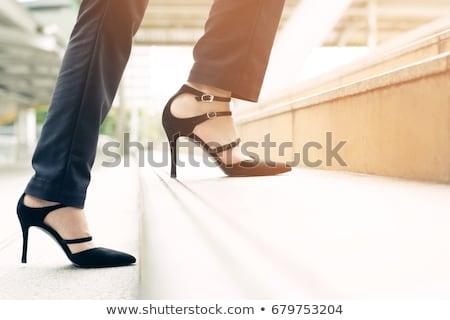 Walking up stairs in high heel shoes Stock photo © roboriginal