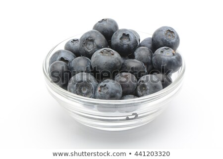 Blueberries in white bowl on colorful blue background stock photo © jaffarali