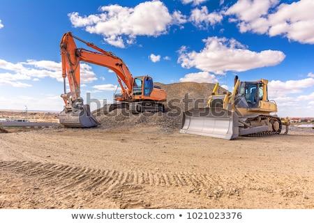 黄色 掘削機 建設現場 空 地球 青 ストックフォト © jordanrusev