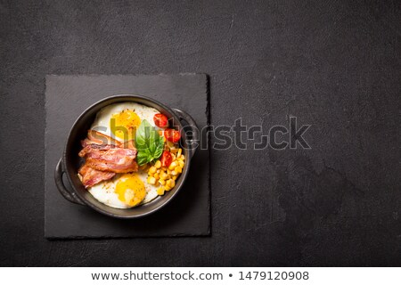 frying pan with fried eggs finished dish stock photo © studiostoks
