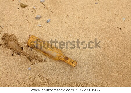 Stock photo: Old bottle at the beach