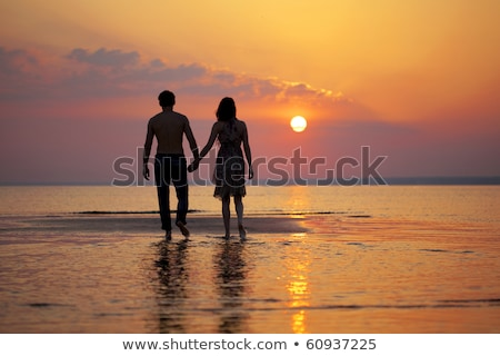 silhouette kissing man and woman on beach Stock photo © Paha_L