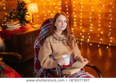 Mujer sesión mecedora retrato hermosa Foto stock © deandrobot