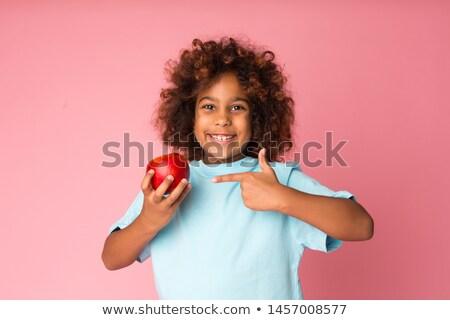 Gyönyörű boldog lány hosszú vörös haj tart alma Stock fotó © deandrobot