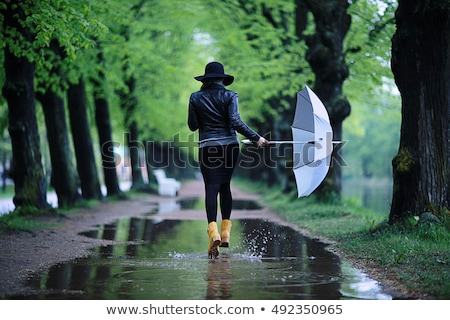Stock photo: girl on street in puddle