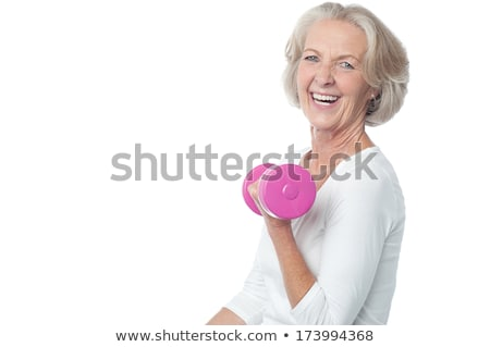 Instructor working with senior ladies in a gym Stock photo © belahoche