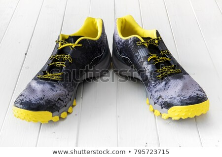 Black sneakers on wooden Stock photo © manaemedia