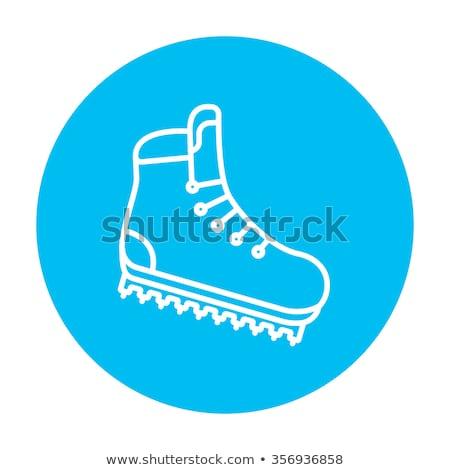 Hiking boot with crampons line icon. Stock photo © RAStudio