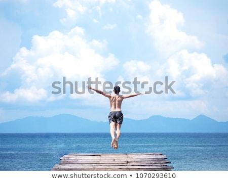 человека прыжки док счастливым озеро воды Сток-фото © zurijeta