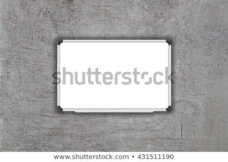 Blank white baord on gray concrete texture background Stock photo © punsayaporn