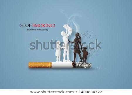 Fumer mort danger cigarette brûlant personnes Photo stock © Lightsource