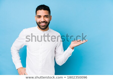 smiling young casual man with hands on waist stock photo © feedough
