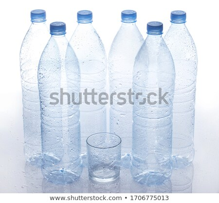 close up of empty used plastic bottle on table stock photo © dolgachov