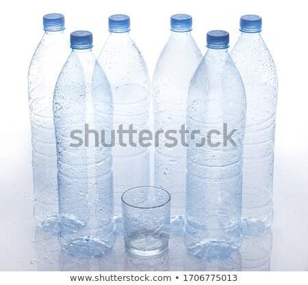 close up of empty used plastic bottle on table stock photo © dolgachov