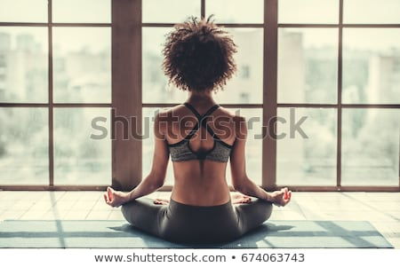 Back view of beautiful african american young woman stock photo © deandrobot