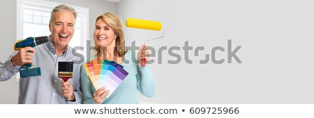 Senior couple with drill and painting roller Stock photo © Kurhan
