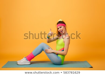Fitness lady make thumbs up gesture. Stock photo © deandrobot