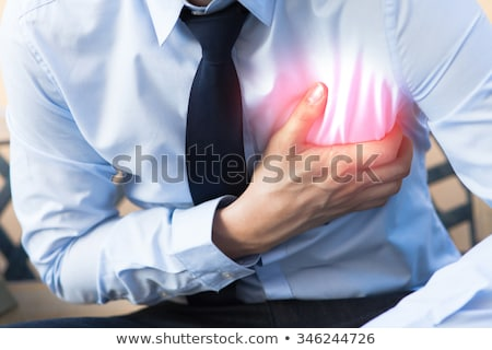 Adult male with heart burn condition Stock photo © stevanovicigor