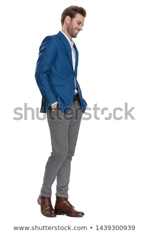 smart casual man standing with hands in pockets looks down stock photo © feedough