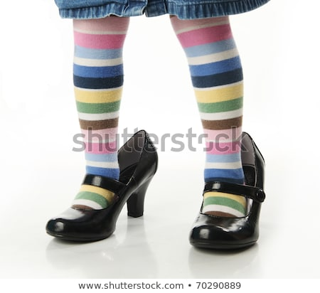 Childs feet in a big black shoes with heels  Stock photo © julenochek
