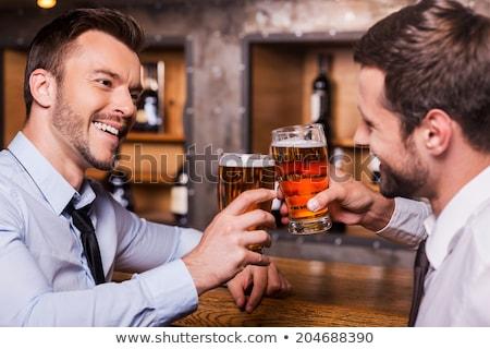 two men having beer together stock photo © wavebreak_media