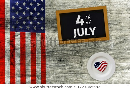 American flag and slate on wooden table Stock photo © wavebreak_media