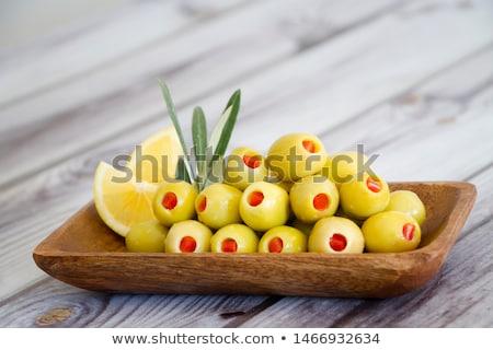Nadziewany zielone oliwek szkła czerwony pieprz Zdjęcia stock © Digifoodstock