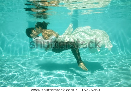 Bride and groom in pool Stock photo © IS2