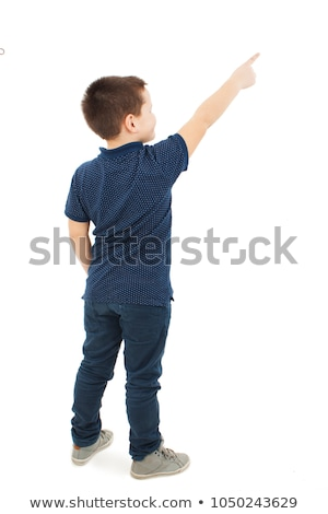 boy pointing up with finger Stock photo © LightFieldStudios
